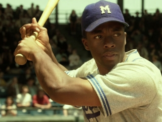 """the movie 42 """"42"""" tells the story of two men—the great jackie robinson and legendary brooklyn dodgers gm branch rickey—whose brave stand against prejudice forever changed the world by changing the game of baseball."""