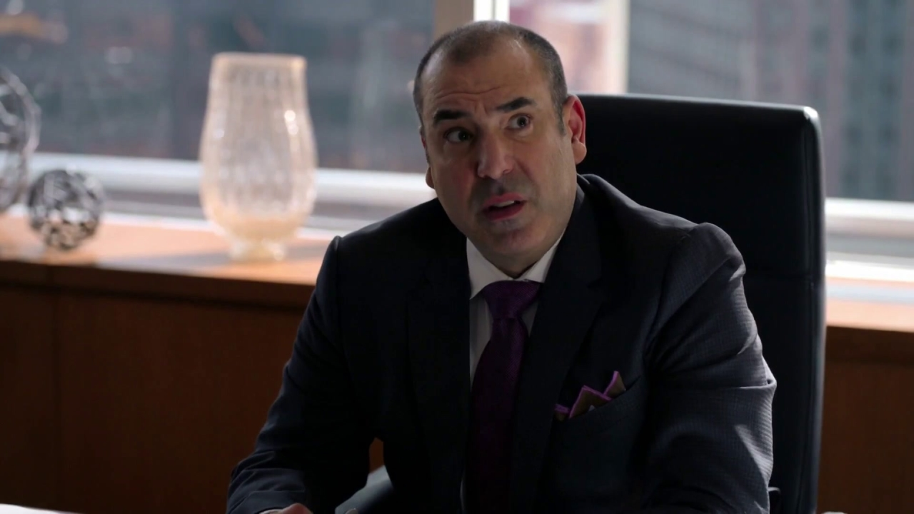 Suits: Donna Gives Louis A Performance Review